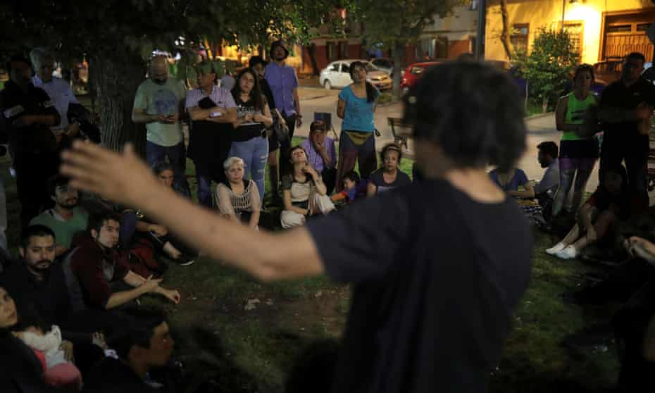 Neighbors gather to discuss the crisis in Santiago.