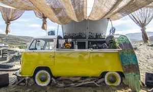 A VW campervan has been converted into a bar at Tinos Surf Lessons in the Cyclades islands.