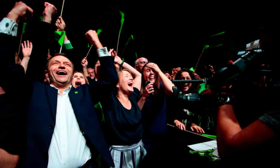 Arild Hermstad, left, of Norway's Green party, celebrates election results two years ago.