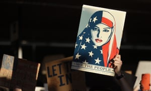 A protester holds a sign at San Francisco international airport during demonstrations against the executive order.