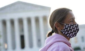 Heather Setzler wears a face mask bearing images of Justice Ruth Bader Ginsburg as she stands outside the supreme court.