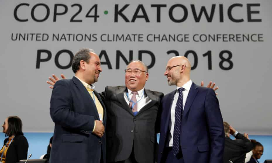 Delegates smile after adopting the final agreement at the COP24 UN climate change conference 2018 in Katowice, Poland.
