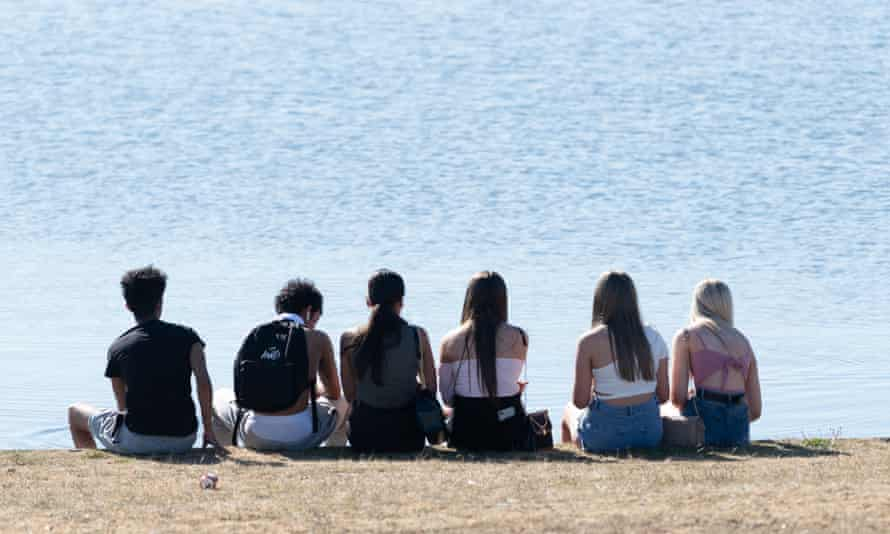 Young Britons gather in Cardiff on the hottest day of the year on May 20, 2020.