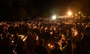 Hundreds of people gather for a vigil in Roseburg, Oregon on 1 October 2015, for 10 people killed and seven others wounded in a shooting at a local community college.