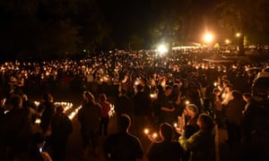 Hundreds of people gather for a vigil in Roseburg, Oregon on October 1, 2015, for ten people killed and seven others wounded in a shooting at a community college in the western US state of Oregon.