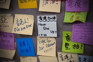 Protest messages are written on post-it notes on the wall of a stairway near the Legislative Council.