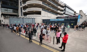 People queuing while waiting for the Covid-19 vaccine outside Croke Park, Dublin, which is being used as a temporary walk-in centre.