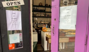 Open door to deli with social distancing signs up during coronavirus crisis (Il Molino in Battersea Park Road, London)