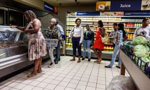 Shoppers queue at a Pick n Pay supermarket in Cape Town