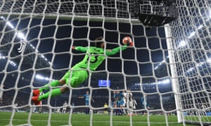 Jan Oblak fails to keep Cristiano Ronaldo's header from crossing the goal line.