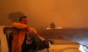 Laurence Cowie watches as fire approaches Tallabrook Lodge