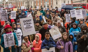 demonstrators march through Brixton in London to protest against Lambeth council's library closure plans in March 2016.