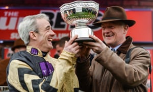 Jockey Ruby Walsh and trainer Willie Mullins celebrate with the trophy after winning the Stayers' Hurdle at the Cheltenham Festival.
