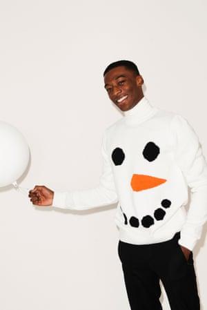 Jumper white black orange snowman face Topman, white roll neck Topman, black trousers Harrods, giant white bauble