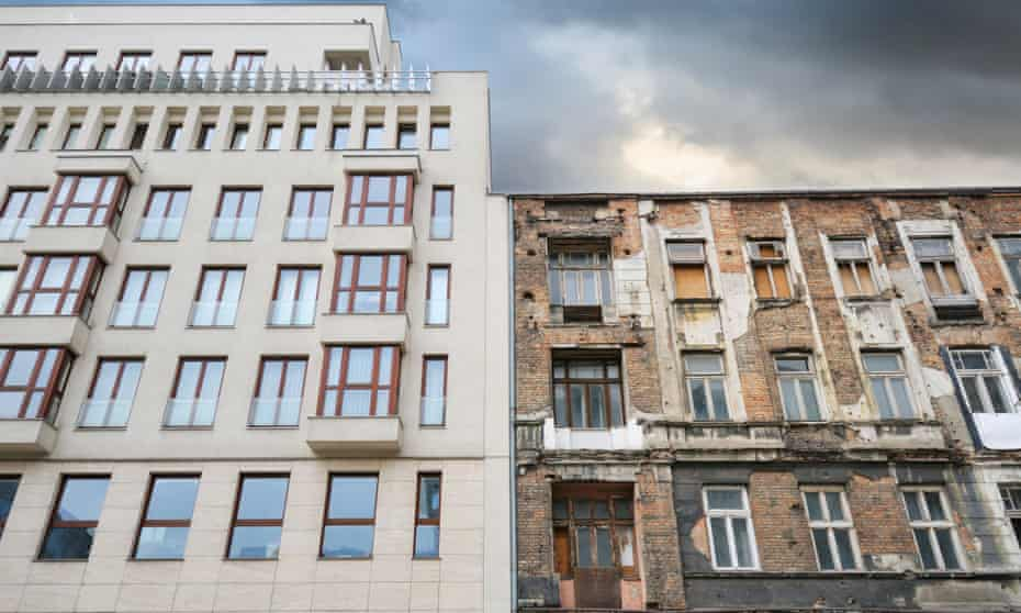 Dilapidated housing, with a modern apartment block behind. Many buildings in Warsaw stand empty because of uncertainty over their ownership.