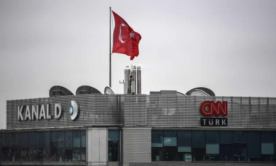 A Turkish national flag flies above Kanal D and CNN Turk television stations.