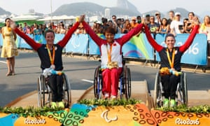 Women's marathon T54 gold medallist Zou Lihong of China is flanked by silver medallist Tatyana McFadden, left and bronze winner Amanda McGrory, right, both of the United States, in Rio.