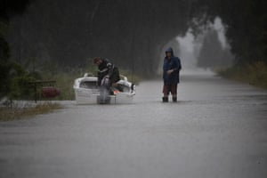 Farmers Zac Atkins and Luke McDonald take their boat down Oxley Island Road