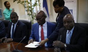 Haiti's ministers for the interior, external co-operation and culture, Jean Marie Reynaldo Brunet, Aviol Fleurant and Joseph Guyler Delva, at a news conference announcing the banning of Oxfam GB.