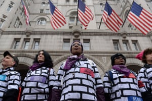 Women wear wall protest outfits as they stand in front of the Trump International Hotel while participating in the Third Annual Women's March in Washington on 19 January 2019.