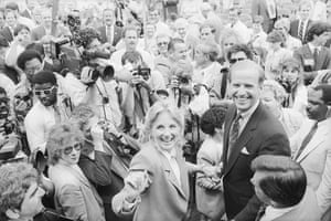 Senator Joseph Biden of Delaware and his wife, Jill, are all smiles as they make their way through a crowd of well-wishers and photographers to take a train to Washington after announcing his candidacy for President of the United States. Biden promised to reawaken the fires of idealism.