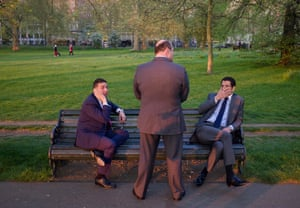 Men in suits on bench