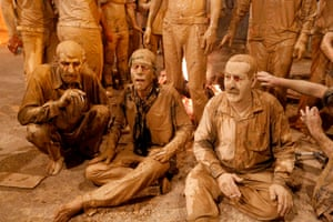 Men after rubbing mud