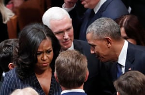 Obama talks with vice-president Mike Pence as he and Michelle arrive.