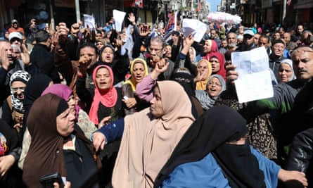 Egyptians protest in front of a government office in Alexandria