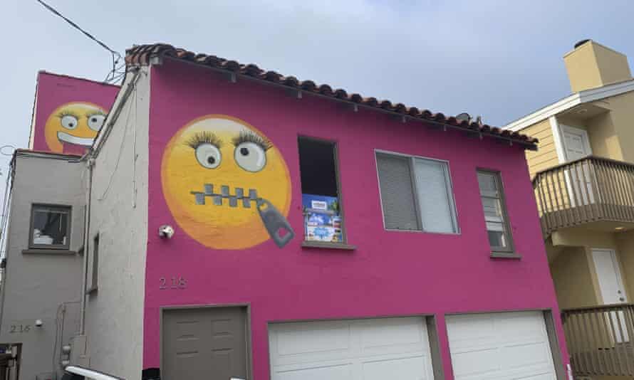 Painted emoji on a house in Manhattan Beach, California, 7 August 2019.