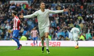 Cristiano Ronaldo celebrates scoring Real Madrid's second against Sporting Gijón