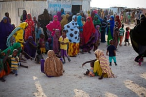 Women wait with their children outside a temporary community centre in the cooler evenings at the Najah camp. The effects of drought are still being felt throughout Somalia, which has forced thousands of people who were pastoralists to seek food and shelter around towns. A Unicef report found eight of the 10 most dangerous places to be born are in sub-Saharan Africa, where pregnant women are much less likely to receive assistance