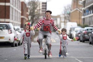 A clown on a unicycle (C) performs ahead of the annual Grimaldi Memorial Service at the All Saints church in east London