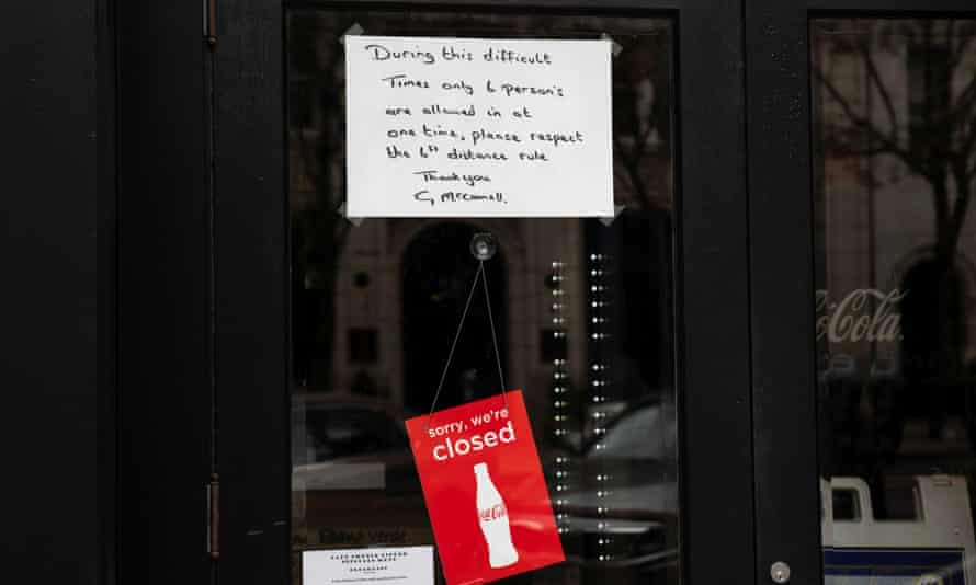 A sign is placed in the window of a restaurant with distancing guidelines as Ohio implements phase one of reopening in Columbus, Ohio, on 1 May.