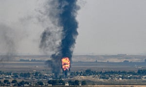 Smoke and fire rise from the Syrian town of Ras al-Ayn in the Turkish offensive against Kurdish groups in north-east Syria in October.