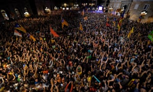 People gather in Barcelona to celebrate the proclamation of a Catalan republic on Friday