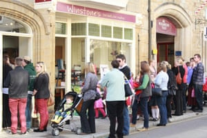 Exterior of Winstone's of Sherborne, with a queue of people outside