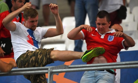 A Russia fan attacks and England supporter during a game at Euro 2016.