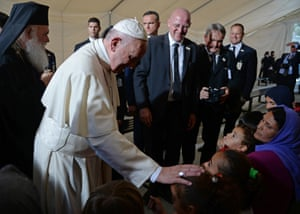 Pope Francis blesses migrants and refugees at the Moria refugee camp