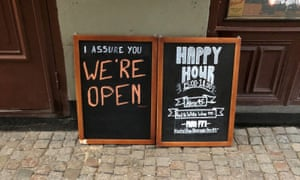 A sign assures people that the bar is open during the coronavirus outbreak, outside a pub in Stockholm, Sweden 26 March 2020.