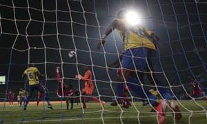 Michael Olunga equalises in acrobatic style for Kenya against Tanzania.
