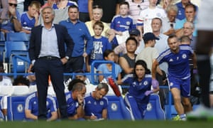 Eva Carneiro and head physio Jon Fearn (right) leave the bench to treat Chelsea's Eden Hazard during last weekend's game against Swansea, as Jose Mourinho looks on.