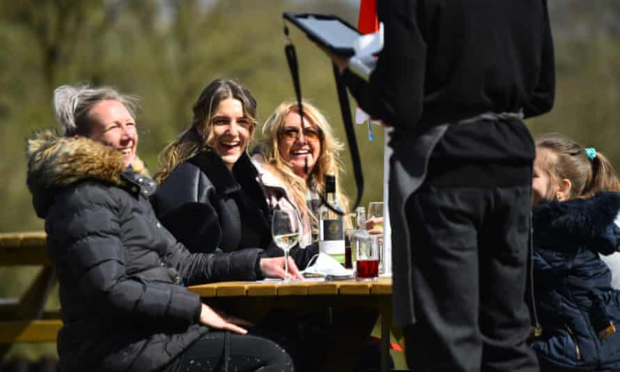 People enjoy a drink in the sun