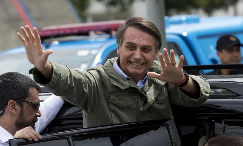 Jair Bolsonaro waves after voting in the presidential runoff election in Rio de Janeiro