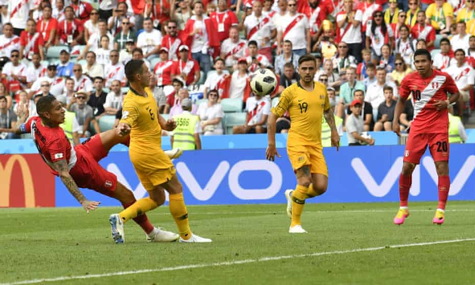 Peru's Paolo Guerrero, left, scores his side's second goal during the World Cup Group C match against Australia at the Fisht Stadium in Sochi.