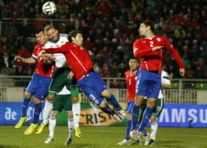 Northern Ireland's Ryan McLaughlin is outnumbered by Chile players during the 2014 friendly.