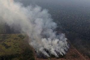 Smoke billows during a fire in an area of the Amazon rainforest near Porto Velho, Brazil.