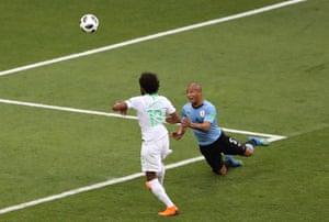 Uruguay's Carlos Sanchez gets under the ball.