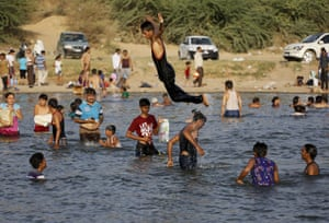 Locals cool off in the Sabarmati river on the outskirts of Ahmedabad
