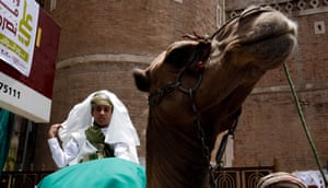 A Yemeni child clad in traditional Yemeni attire rides a camel during a rally against the Saudi-Hajj pilgrimage ban.